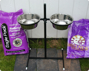 Double bowl feeding tower and 33# bags of quality kibble.