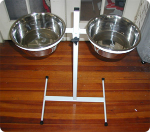 Adjustable dog feeder shown in custom white powder coat.